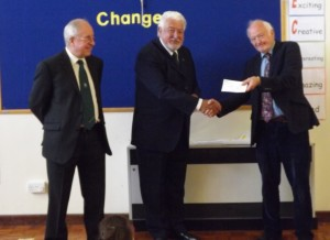 Master W.Bro. John Kemp (centre) presenting a cheque for £500 to Glynn Rowlands (right) of Woolgrove School. Watched by the Lodge Charity Steward W.Bro. John Clark (left)